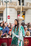 Holy Week in Malaga, Spain. Girl with staff in Palm Sunday proce Stock Photos