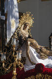 Holy Week in Seville Jesus died in the arms of his mother, brotherhood of Baratillo Stock Image