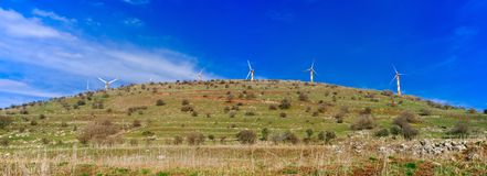 Holyland Series - Golan Heights Windmills panorama. Wind Mills at Hasnia Mt. on the Border between Israel and Syria Royalty Free Stock Photography