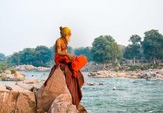 Holyman, Orchha Rajasthan, India. A Sadhu (holyman) meditating at the bank of Betwa River Stock Photos