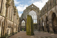 Holyrood Abbey in Edinburgh, Scotland. Ruins of Holyrood Abbey in Edinburgh, Scotland Royalty Free Stock Images