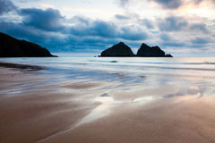 Holywell Bay. Moody sunset on the beach at Holywell Bay Cornwall England with Carters Rocks in the distance Royalty Free Stock Photos