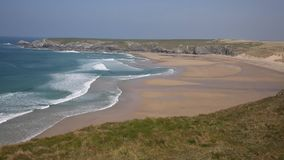 Holywell Bay Cornwall coast England UK near Newquay and Crantock in spring with blue sky PAN stock video
