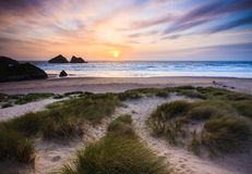 Holywell Bay Cornwall. The sun setting over Holywell Bay Beach viewed from the Sand Dunes, Cornwall England UK Stock Photo