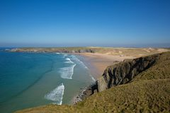 Holywell Bay North Cornwall with waves beach and coast on a beautiful day. In spring royalty free stock photo