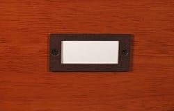 Holz mit Namensschild Stockbild