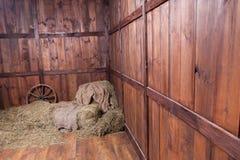 Holz- und Heuhintergrund Stockbild