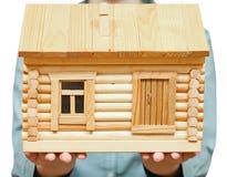 Holzhaus auf Palmen Stockfotos