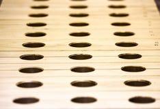 Holzklötze mit Löchern Stockbilder