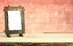 Holzrahmen auf Tabelle mit bokeh Hintergrund Stockfotografie