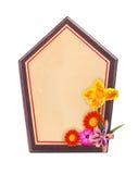 Holzrahmen mit Blume am Ecken- und Urlaubraum für das Addieren von te Lizenzfreie Stockbilder