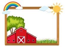 Holzrahmen mit roter Scheune und Regenbogen Lizenzfreie Stockfotografie