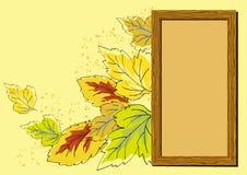 Holzrahmen und Herbstblätter Stockbild
