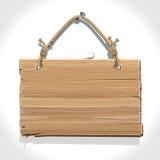 Holzschild mit dem Seil, das an einem Nagel hängt. Stockfotos