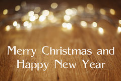 Holztisch-frohe Weihnacht-guten Rutsch ins Neue Jahr Lizenzfreies Stockbild