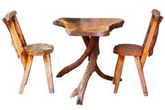 Holztisch mit den Stühlen lokalisiert Lizenzfreie Stockfotografie