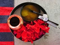 Homa - Hawan - Agni hotra: Items for the Hindu fire ritual. Ghee and flowers stock image