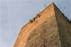 Homage Tower of Olivenza castle with plane trail Royalty Free Stock Image
