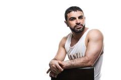 Hombre árabe brutal en un fondo blanco fotos de archivo