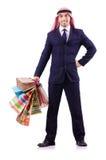 Hombre árabe con los regalos de las compras Fotografía de archivo