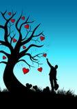 Hombre - árbol - corazones Foto de archivo libre de regalías