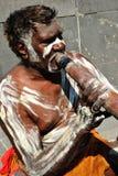 Hombre aborigen con Didgeridoo Imagen de archivo libre de regalías