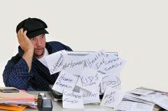 Hombre abrumado con finanzas Fotografía de archivo