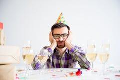 Hombre aburrido en el partido Fotos de archivo