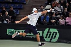 Hombre Adrian Ungur del tenis en la acción en un partido de la Copa Davis Imagen de archivo libre de regalías