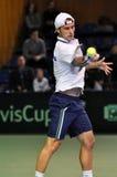Hombre Adrian Ungur del tenis en la acción en un partido de la Copa Davis Foto de archivo libre de regalías