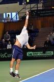 Hombre Adrian Ungur del tenis en la acción en un partido de la Copa Davis Imágenes de archivo libres de regalías
