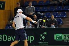 Hombre Adrian Ungur del tenis en la acción en un partido de la Copa Davis Fotografía de archivo libre de regalías