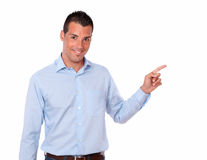 Hombre adulto hermoso que señala a su izquierda Fotos de archivo