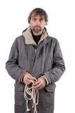 Hombre adulto que lleva a cabo la cuerda Imágenes de archivo libres de regalías