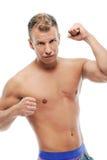 Hombre adulto sin la camisa que presenta en estudio Imagen de archivo libre de regalías