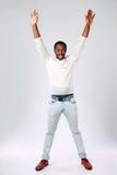 Hombre africano con las manos aumentadas Imágenes de archivo libres de regalías
