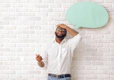 Hombre afroamericano con la burbuja del discurso Foto de archivo libre de regalías