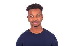 Hombre afroamericano joven aislado en el fondo blanco - negro Fotos de archivo libres de regalías