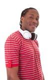 Hombre afroamericano joven con los auriculares - personas negras Imagen de archivo