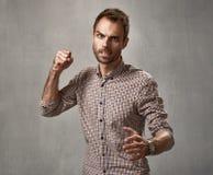 Hombre agresivo Foto de archivo libre de regalías