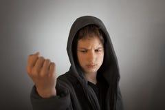 Hombre agresivo en la máscara Imagen de archivo