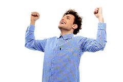Hombre alegre con las manos aumentadas para arriba Foto de archivo