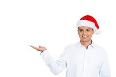 Hombre alegre de Navidad con su palma de la mano para arriba Fotos de archivo