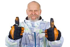 Hombre alegre en el traje de esquí que muestra los pulgares para arriba Imagenes de archivo