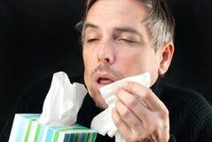 Hombre alrededor a estornudar Imágenes de archivo libres de regalías