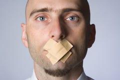 Hombre amordazado Fotos de archivo libres de regalías