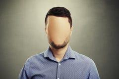 Hombre anónimo con la cara en blanco imagen de archivo libre de regalías