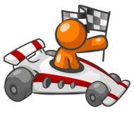 Hombre anaranjado en coche de carreras Foto de archivo libre de regalías