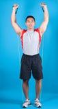 Hombre apto con la venda del estiramiento del ejercicio Fotografía de archivo