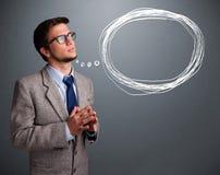 Hombre apuesto que piensa en burbuja del discurso o del pensamiento con el co Imagen de archivo